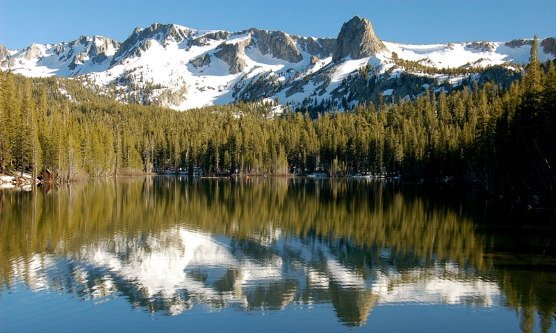 Snow covered mountains above a lake in Mammoth Lakes Basin